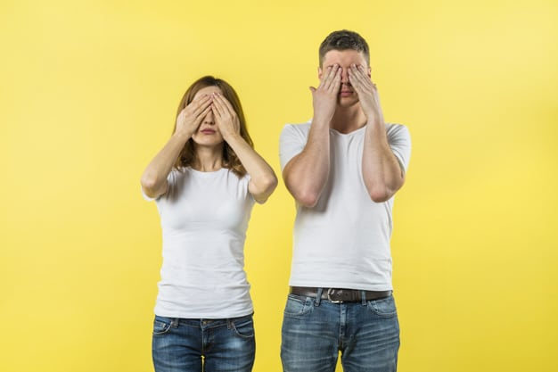 young-couple-covering-their-eyes-against-yellow-background_23-2148056157