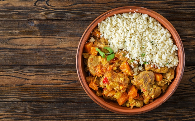 traditional-tajine-dishes-couscous-fresh-salad-rustic-wooden-table-tagine-lamb-meat-pumpkin-top-view-flat-lay_2829-6116